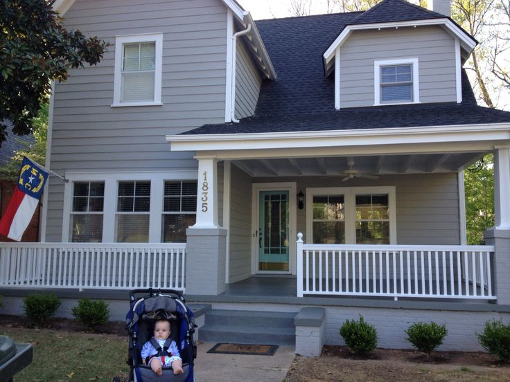 New paint job and bushes house: Benjamin Moore Platinum Grey door: Benjamin Moore tame teal