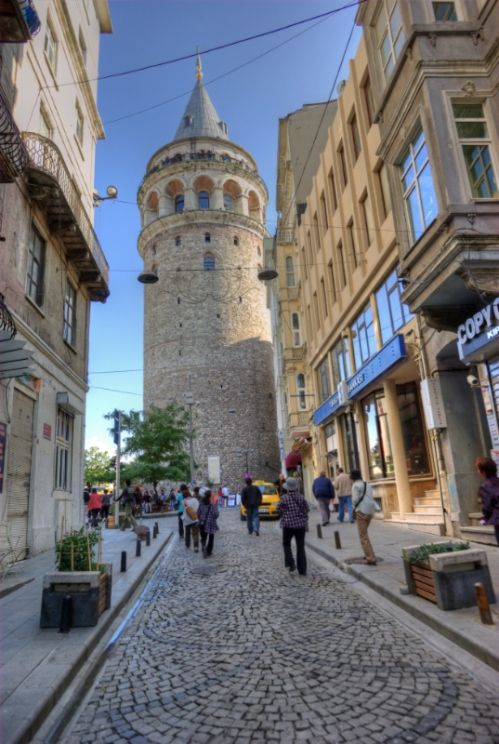Galata Tower (Turkish: Galata Kulesi), Christea Turris (Tower of Christ) by the Genoese and Megalos Pyrgos (The Great Tower) by the Byzantines - Istanbul, Turkey. It's a huge, cone-capped cylinder that dominates the skyline on the Galata side of the Golden Horn.  The tower was built as Christea Turris in 1348. It was the apex of the fortifications surrounding the Genoese citadel of Galata.
