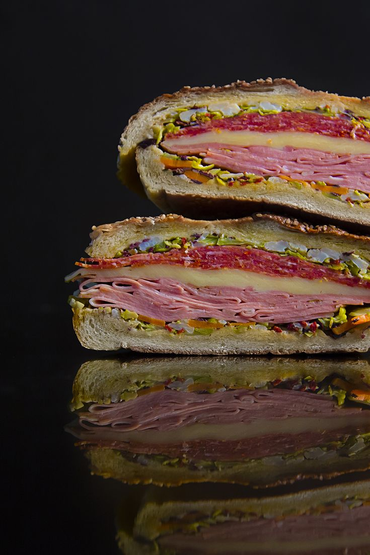 Say hello to the muffuletta, New Orleans's iconic sandwich of cheese, meat and olive salad. Here's where to get the city's best—as well as how to properly eat it.