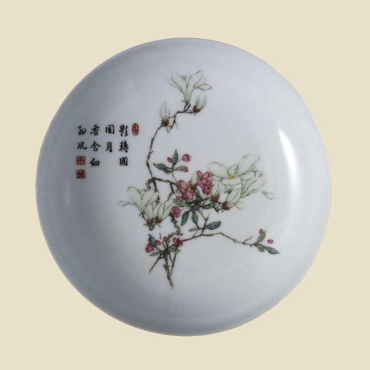 Pair of Falangcai saucer-dishes. Saucer-shaped fine thin white porcelain dish. Decorated 'Gu Yue' style in 'famille rose' enamels. Inside is a delicately drawn design of blossoming magnolia and peach spray together with a poetical inscription with three seals in red enamel. Pair with PDF 857. PDF 856