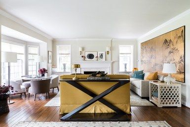 """Dougan created three seating areas—the Max Alto games table, a center sofa facing the fireplace, and a trio of furniture consisting of a second couch, ottoman, and a lounge chair. """"Most game tables are 29"""" tall. This one is 26"""" high, allowing for chairs the same height as the sofas,"""" says the designer. """"Having all the seating at the same level is key in keeping a connection for eye contact and conversation. It's psychological."""" 