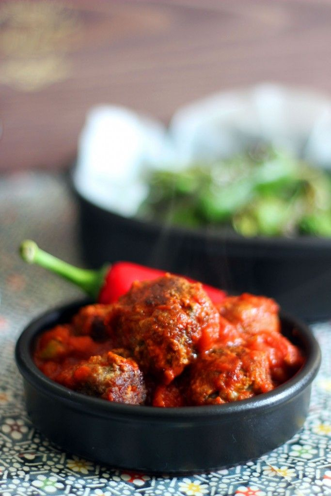 These spicy chorizo meatballs are served in a rich ...