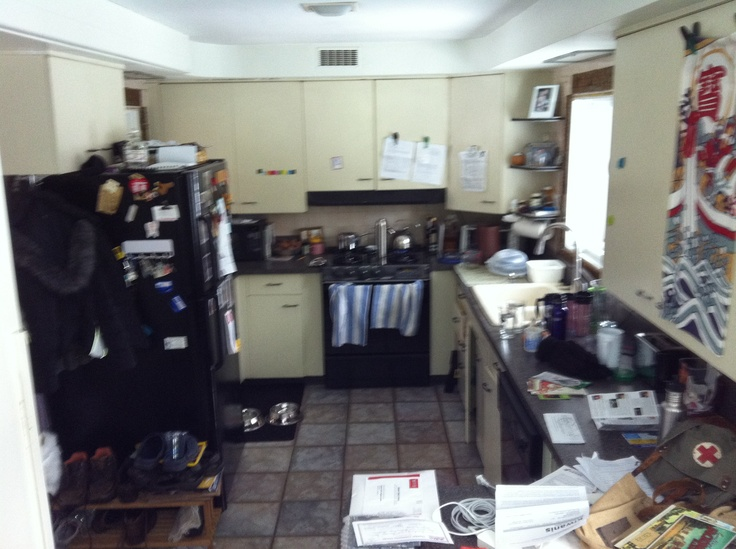 Our existing (& very cluttered) kitchen - Metal cabinets original to the house, which was built in 1952. The floor was installed about 10 years ago.