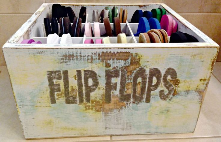 Here is a DIY Flip Flop Bin to organize your flip flops. Use stain, paint, a rope and sandpaper to give a worn beach vintage look to this wooden box.