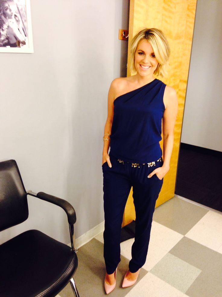 Ali Fedotowsky wearing the Lulu Jumpsuit in Navy on the set of E! News