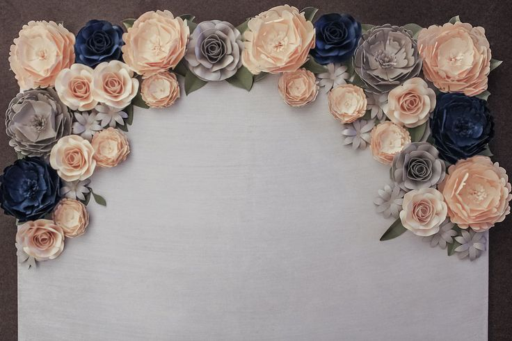 Designs paper flowers, paper flower backdrops, wedding/event decor, paper flower wedding centerpieces, backdrop rentals and bouquets for clients worldwide.
