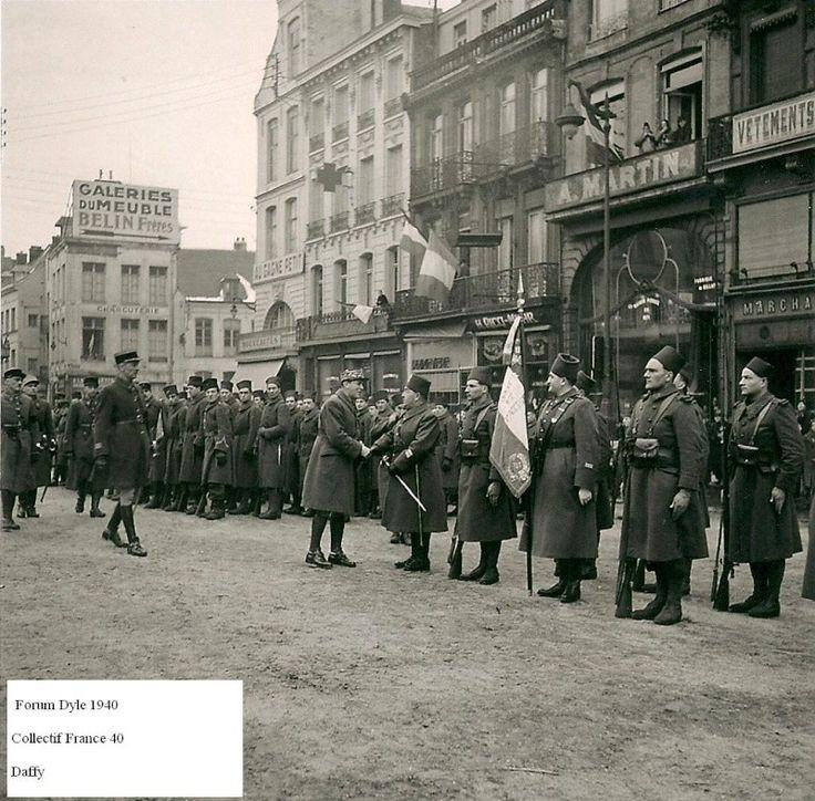 11th Zouaves with the flag presented to General Blanchard Valenciennes.19 March 1940. 11eme zouaves avec son drapeau présenté au général Blanchard à Valenciennes.19 mars 1940.
