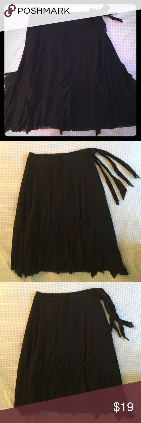 """VERY FEMININE ONLY HEARTS NYC BLACK SKIRT. Very feminine Only Hearts NYC black skirt. Purchased st a boutique, Lola Bella in Boca Raton Florida.This is a great versatile piece. Has very subtle petals around it. Can be worn very casual with a tank and flip flips or dressy with a nice top and shoes. Material is 100% Nylon. Worn once for a few hours. From waist to hem 19"""". Size SP. Skirts"""