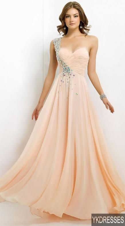 Prom is like 2 years away and I hate the fact that the traditional prom dress is long but if I had to pick, this is one of the choices...in a different colour.