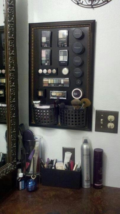 GREAT FOR BATHROOMS WITH LIMITED COUNTER SPACE: Get a cheap frame from the dollar store and a magnet board (similar to ones for lockers) spray paint whatever color of choice. Use two plastic soap holders, spray painted to match, to hold your brushes, etc. Buy magnetic strips from any craft store and place on bottoms of your makeup. VOILA!