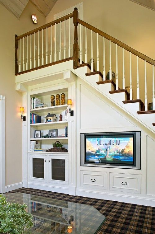 Built-in under stairs. Would be cool as a 2nd floor loft with stairs going to attic.: