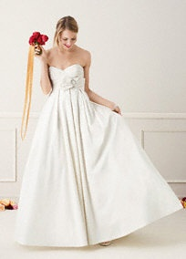 The modern ball gown for the trendy bride, this strapless shantung taffeta gown is a definite winner.  Strapless sweetheart bodice is flattering while bow with brooch at waist adds a touch of fun.  Side pockets make this ultra chic style super comfortable.