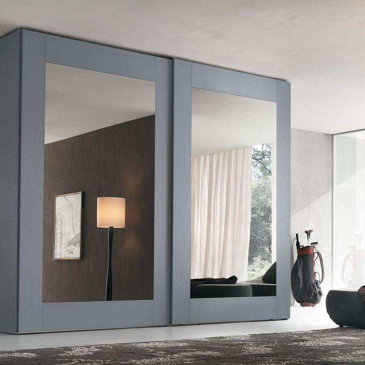 Mirror sliding wardrobe of Player collection with white glossy lacquered glass door panel and white open pore lacquered oak door frame and external sides