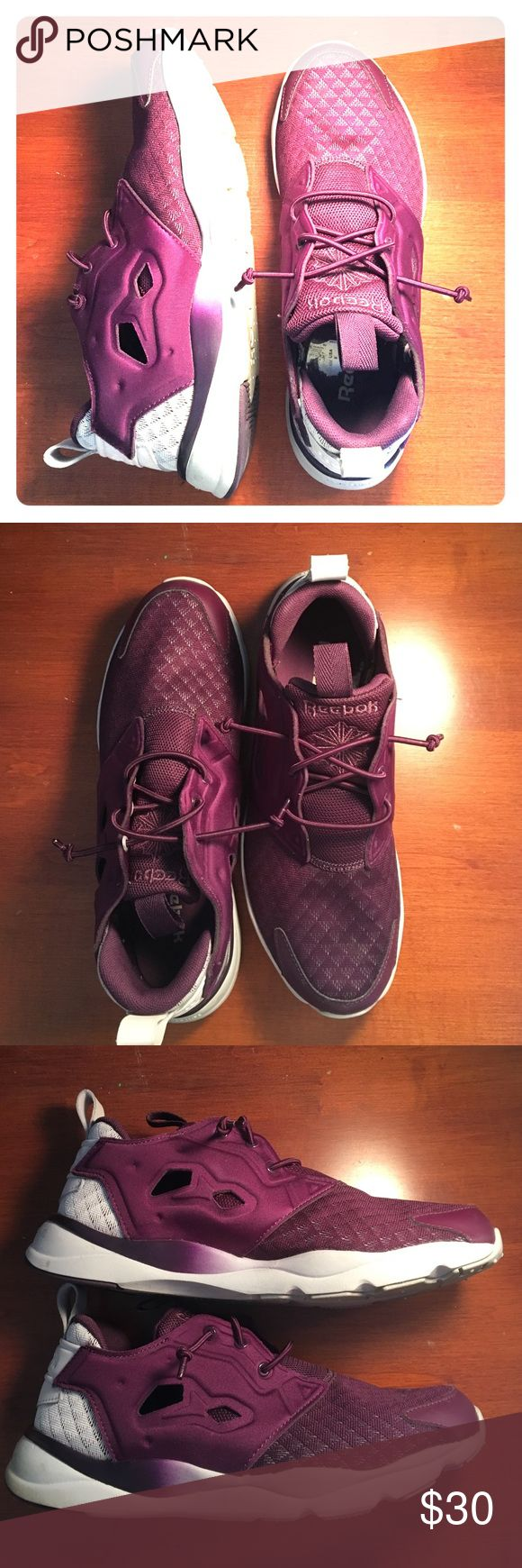 Purple Reebok Furylite Sneakers Purple no-tie furylites have white soles and white accents on the back. Slight discolor of the white under soles, shoes have been worn 5-10 times total. Shoes have a breathable, diamond fabric with solid purple side pieces. Reebok Shoes Sneakers