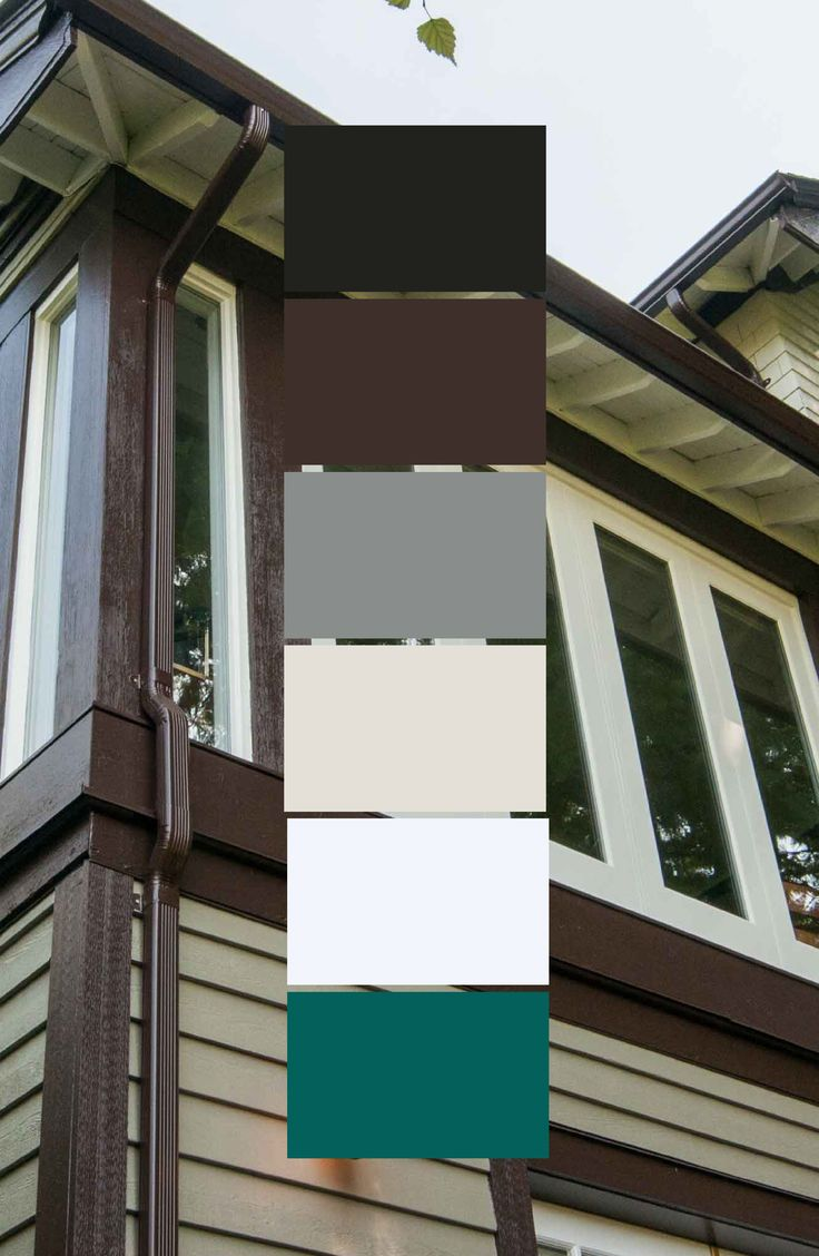 This North Vancouver heritage tudor home was painted using Benjamin Moore Hampshire Gray, Tartly Brown, Camouflage, and Bavarian Cream. Together this colour palette provides a classic look, especially when the door is a bright colour like Benjamin Moore's Grand Entrance paint in Tavern Door.