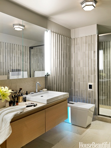 Retro Chic Bathroom. In the master bath of a Andy Warhol-inspired apartment, designed by Groves, Veranda Bamboo tiles by Ann Sacks are reminiscent of a fluted column and add texture to the natural palette.
