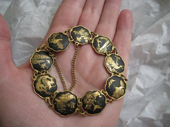 Adorable midcentury Japanese amita damascene bracelet.