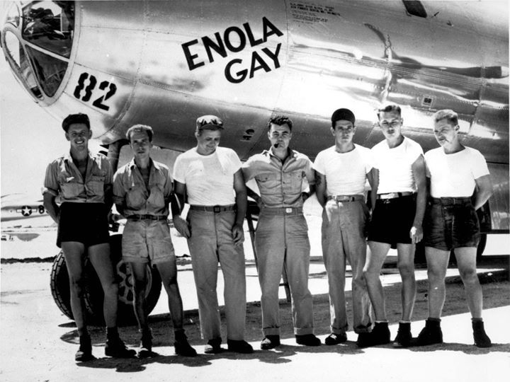 """The Enola Gay dropped the """"Little Boy"""" atomic bomb on Hiroshima. In this photograph are five of the aircraft's ground crew with mission commander Paul Tibbets in the center."""