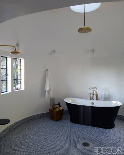 A Hollywood Classic: In the master bath, the showerhead and fittings are by Barber Wilsons.
