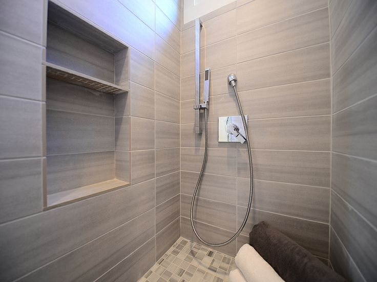 Pic On This elegant install features Emser Perspective White for the shower walls and Metro White Shower Floor Mosaic