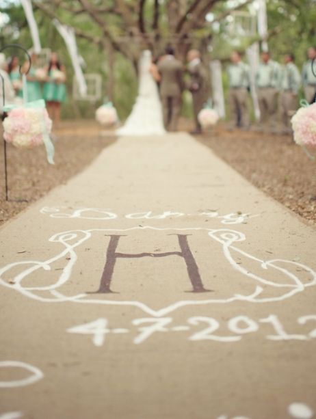 Burlap wedding aisle runner with the couple's monogram painted on.