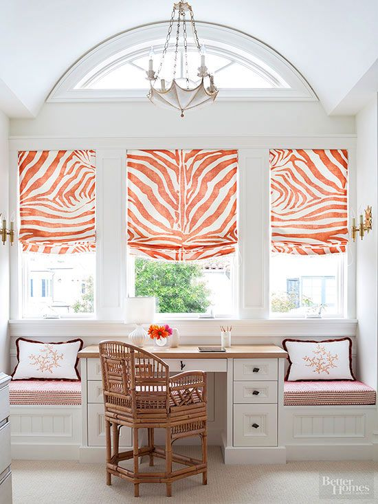 Putting even more attention on the grand architecture, orange-and-white zebra-print Roman shades dress the trio of windows in this study. Choosing custom treatments to fit the different widths of windows (the one in the middle is larger) allowed the designer to use a choice fabric. Above, an arched window needs no dressing; it's high enough that privacy is a nonissue.