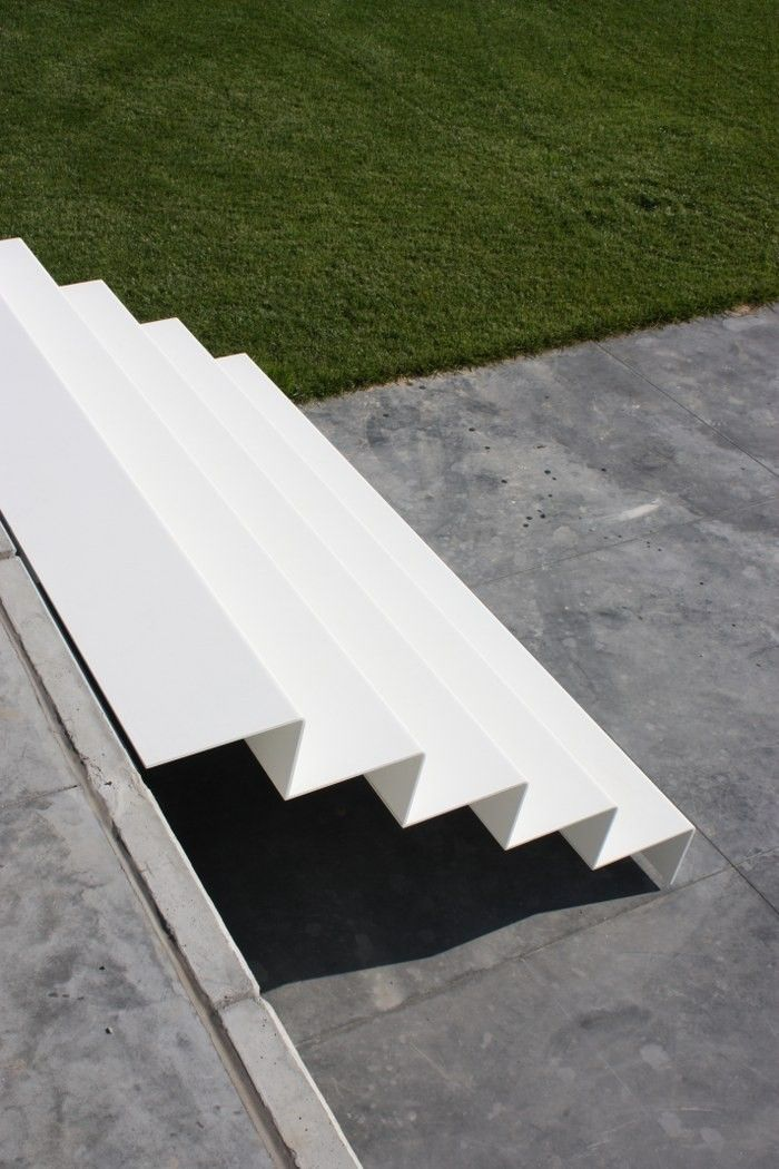 Staircase in white lacquered steel with z-shaped steps. Very modern design.