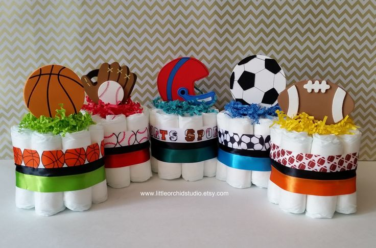 Set of 5 Mini Sports Diaper Cake/ Boys Diaper Cake/ Baby Shower Center Pieces/ Baby Shower Decor/ Sports Theme/ Mommy To be/ Football Mom by LittleOrchidStudio on Etsy https://www.etsy.com/listing/263956152/set-of-5-mini-sports-diaper-cake-boys