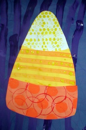 Candy corn!  Same color paint print on construction paper to create this effect.  Love the different textures!