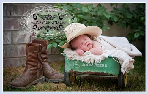 He'll grow up to fit those boots his daddy wore... oh my gosh this is so cute!