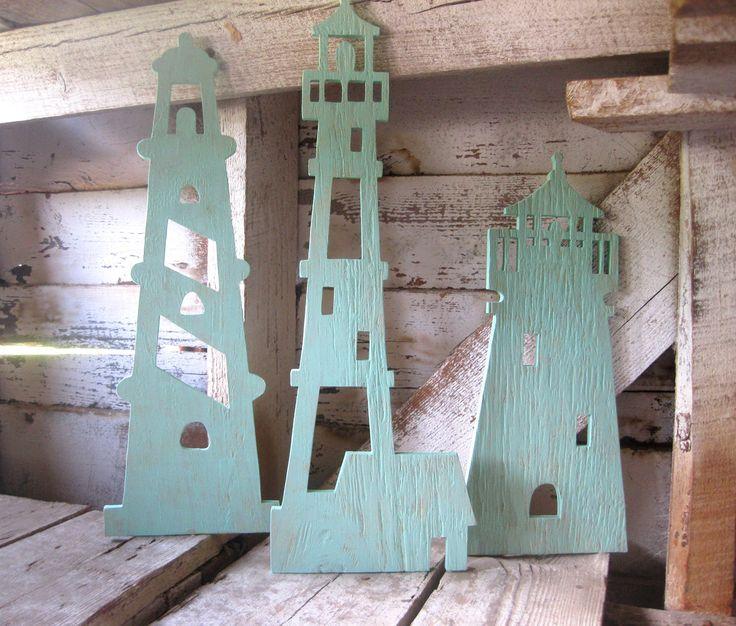 3 Lighthouses, wood wall art, beach decor, nautical, cottage, coastal, distressed, shabby chic. $135.00, via Etsy.