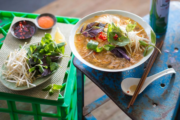 """""""This noodle soup dish originated from Hanoi, however it can be found all through the streets of Saigon. It is much loved by locals as it has such depth of flavour and a great cooking technique to make the wonderfully textured crab balls, known as rieu."""""""