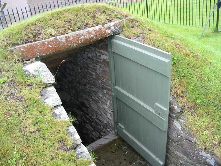 Earth house door, storm cellar, root cellar - put your yard toys in there....... love the door.