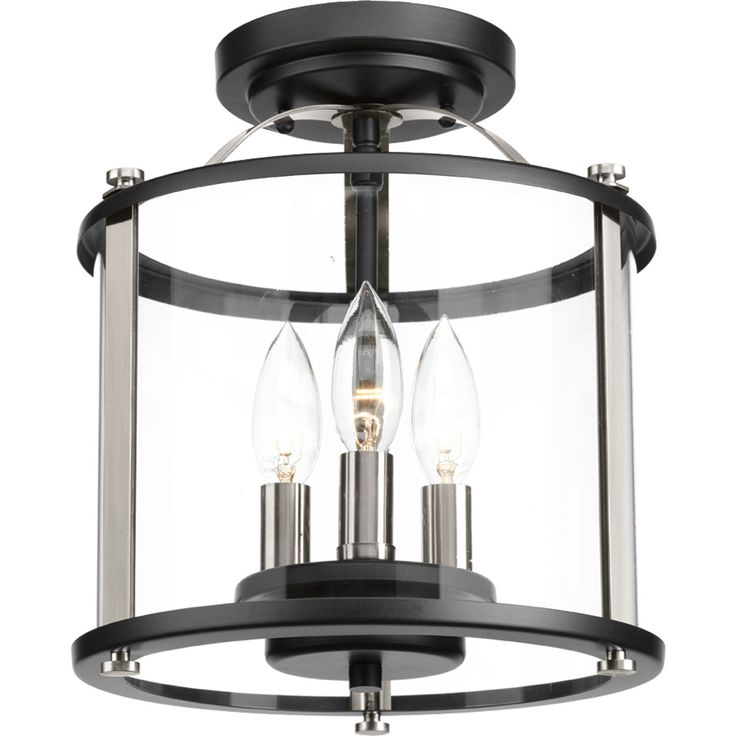 Three Light Semi Flush Convertible Squire lanterns feature a classic traditional profile with clean, modern metal fittings. Accented with contrasting metallic elements, the cylindrical frame is comprised of a clear glass diffuser.