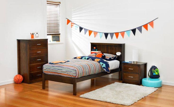 Jamie Australian Made kids timber bedroom furniture suite with blue, orange and grey patterned linen and décor. Available at Forty Winks.
