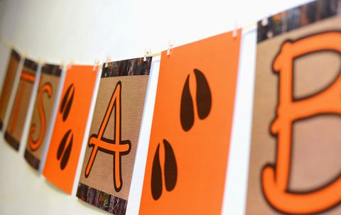 One It's A Boy orange, hunting camouflage and deer track baby shower banner kit. Perfectly coordinates with our camo & deer custom baby shower invitations!