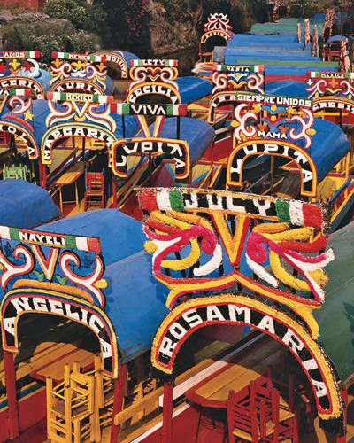 ELLE DECOR GOES TO MEXICO CITY    Boats along a canal in the Xochimilco district.