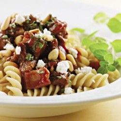 Lamb and eggplant packed with complex, hearty, earthy flavor that's truly satisfying. Ground lamb is effortlessly flavored with fennel seed, oregano, and red wine. Toasted pine nuts and tangy feta cheese top off this wonderfully comforting end of the whole family dinner are excellent accents.