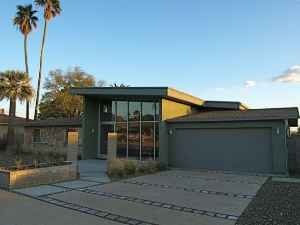 Love the dramatic driveway and how the middle section of the home breaks the straight line of the original design. Modern Home Design with a Mid-Century flair - 2 car garage
