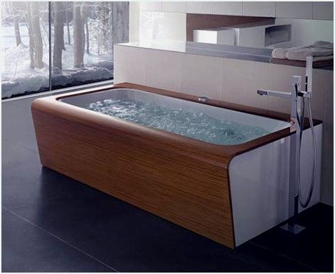 Bathtubs With A Beautiful Wooden Finish | These three new amazing whirlpool bathtubs ( the Yuma Art, Kyra Art and Naja Art ) from BluBleu are taking the bathtub to another level. These new designs have a beautiful wooden finish + soothing chromo relax system, and invigorating air system (for a hydromassage), and they look more like a piece of furniture. For more informations about these bathtubs go to Trendir<!--more-