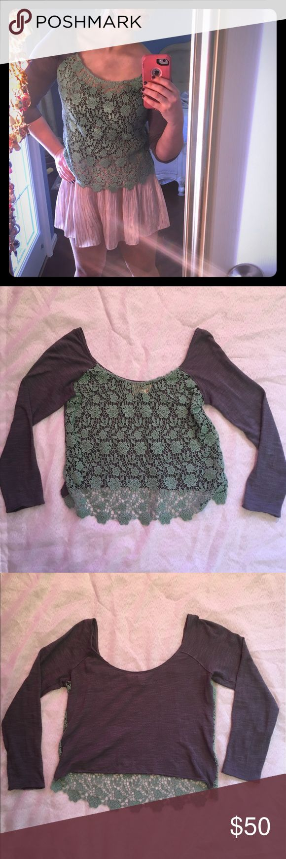 Free People Front Crochet Top Beautiful gray shirt with mint green crocheting on the front and 3/4 length sleeve.  This is a gently used NWOT Free People shirt that is very flattering on all with no visible damage that I can see.  The  crocheting hides a multitude of sins.  Lol  As you can see the crochet layer dips below the light weight shirt in the front.  Great for all seasons, but especially good for spring and fall. Free People Tops Blouses