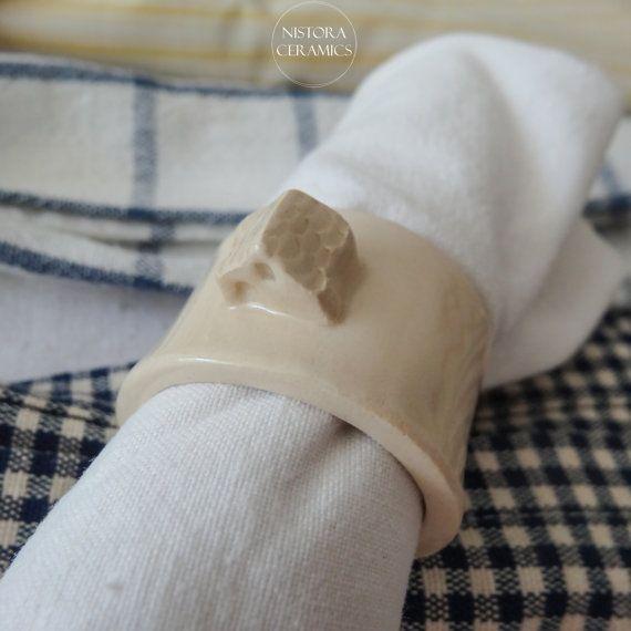 Handmade off-white ceramic napkin rings with little ceramic house on top
