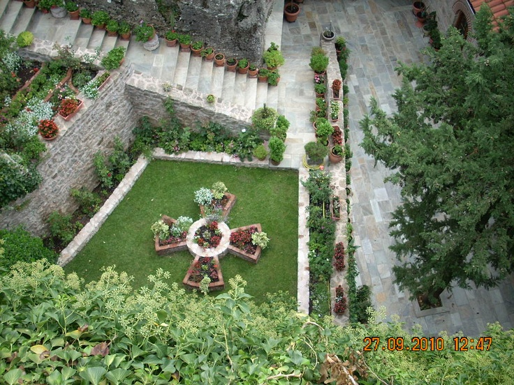 a small garden in the middle of the monastery
