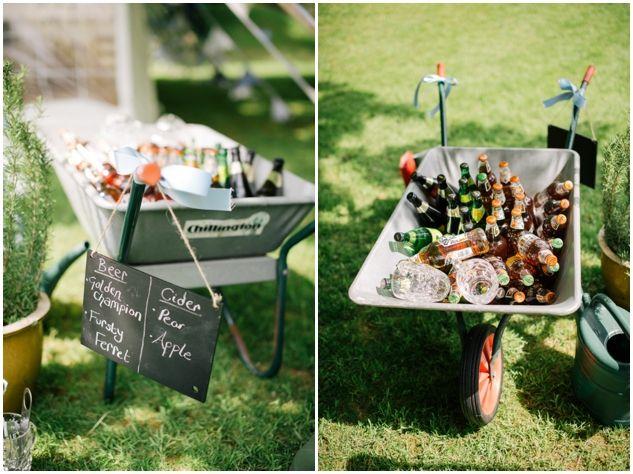 beer + cider in a wheelbarrow = awesome idea at this country garden wedding | Matt Bowen Photography http://mattbowenphotography.co.uk/  See the full wedding here: http://bridalmusings.com/2013/08/english-garden-wedding-matt-bowen-photography/