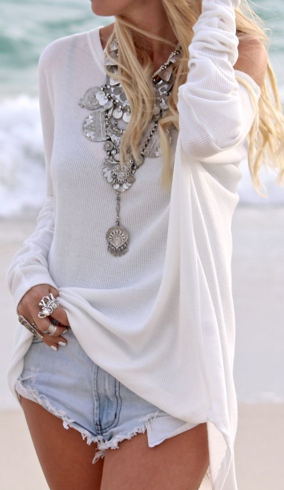 White Off the shoulder sweater, high cut offs, chunky silver rings, statement necklace, tousled hair. Perfect.
