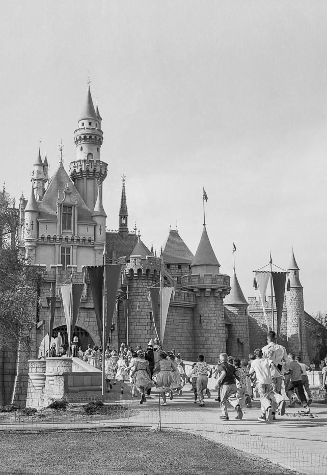 July 17, 1955 -- Children rush into the Fantasyland castle at Disneyland on opening day
