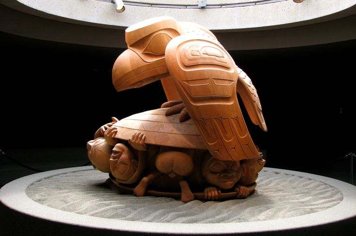 Bill Reid: Raven and The First Men, UBC Museum of Anthropology. It depicts part of a Haida creation myth. The Raven represents the Trickster figure common to many mythologies.