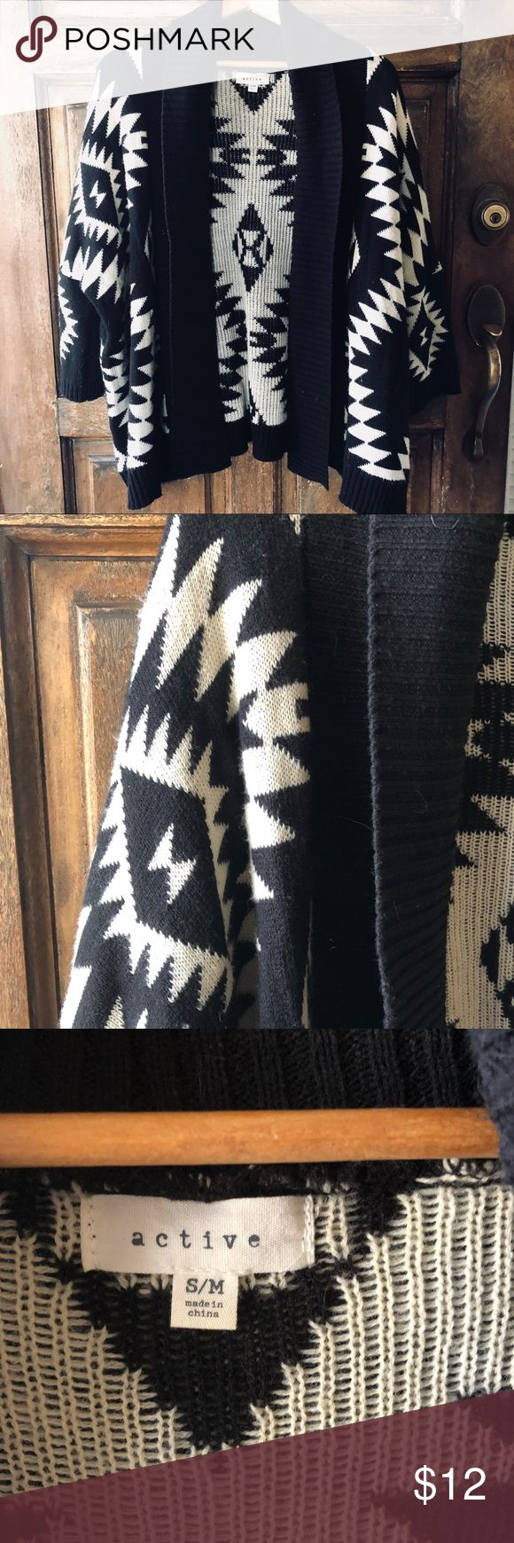 """Aztec Print Cardigan Perfect cozy sweater for spring and summer nights! Great neutral colors that go with a variety of colors! Market size small/medium but has an oversized fit. Cardigan is 29"""" in length and has 3/4 or 7/8 length sleeves (depending on arm length). Material is 100% acrylic. active Sweaters Cardigans"""