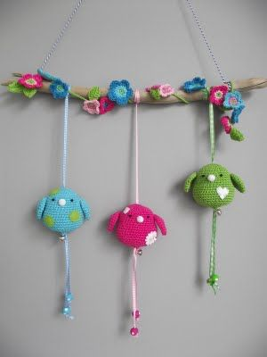 Crochet birds... @Hannah Mestel Medlin what about this one with the stuff hanging and flowers? could you do this one or do you need a pattern?