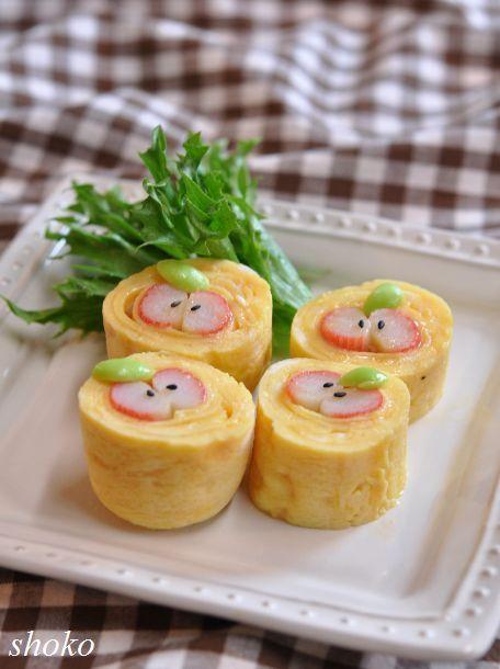 Kids Meal Idea: Tamagoyaki Egg Omelete Apple (Japanese Kanikama Surimi Fish Stick, Half Green Bean, Black Sesame Seed)-- we have a recipe for Japanese omelettes in the Sushi Chef Cookbook!